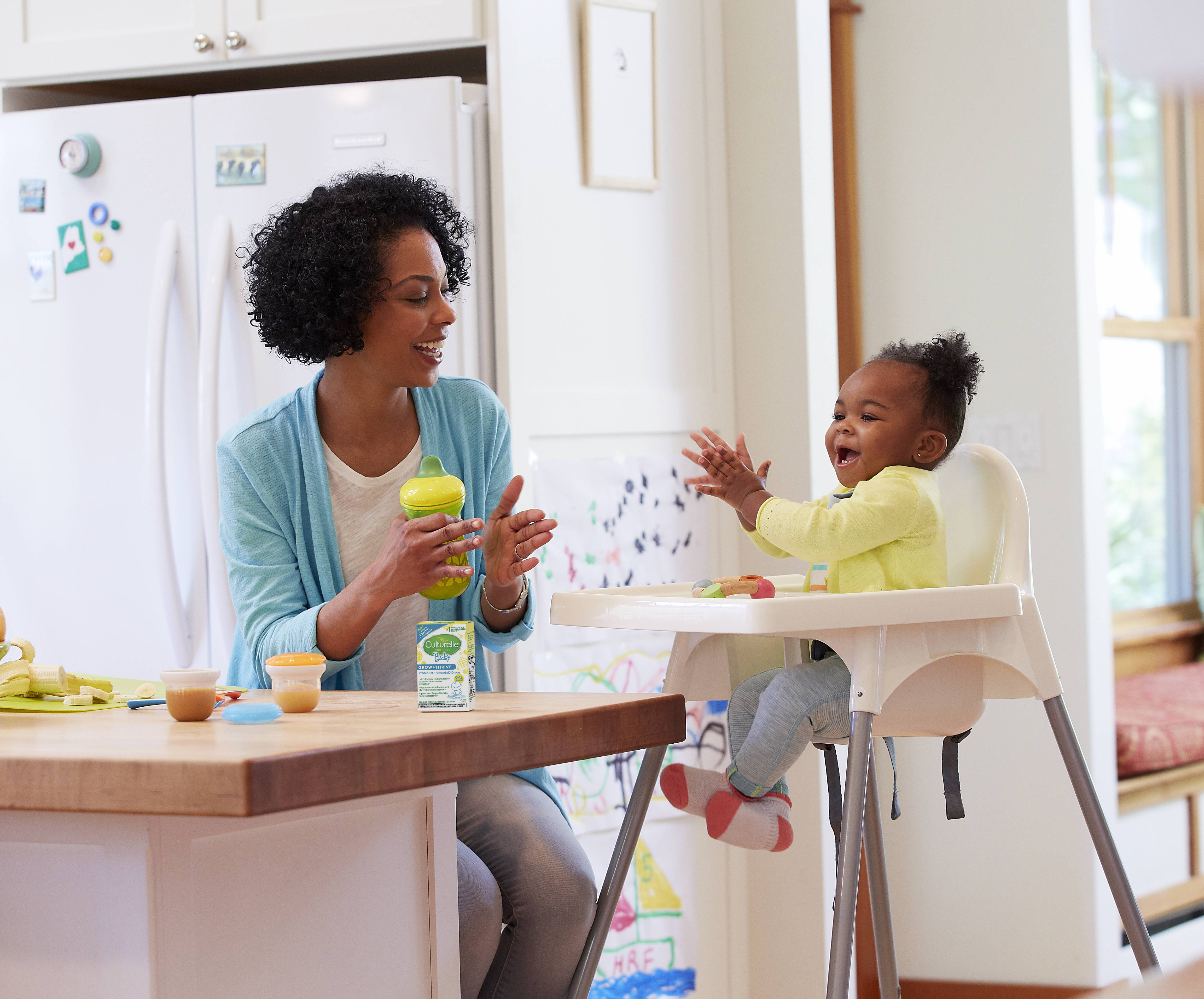 woman giving her daughter the Culturelle® Baby Probiotics